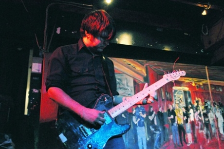 Six Organs of Admittance tours abroad, making the backpacking American feel at home