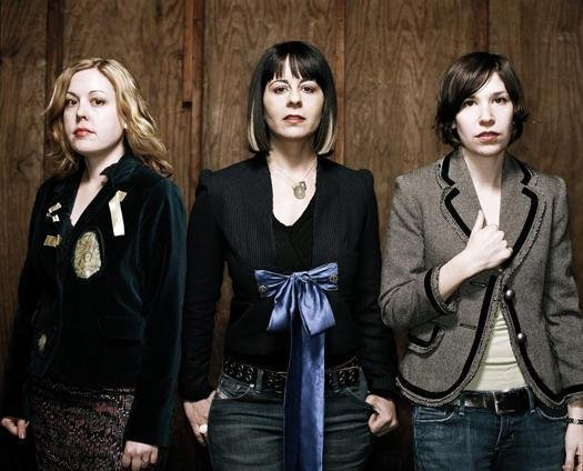 Sleater-Kinney reunite, announce new album, and announce their intent to smooch numerous cities on the face