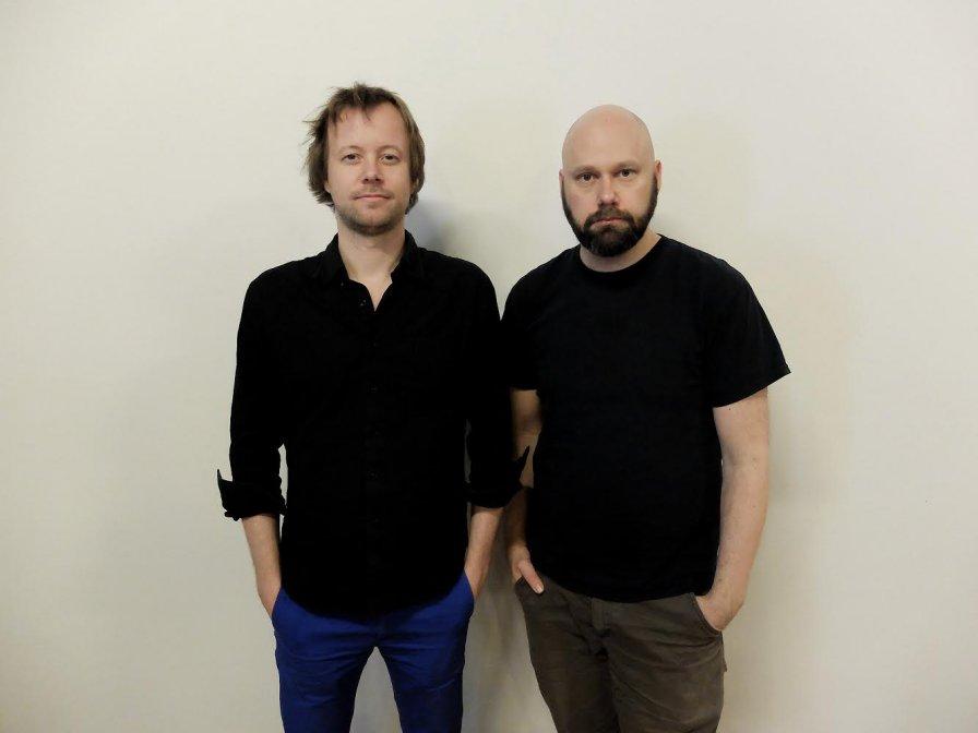 Kim Myhr & Lasse Marhaug, with heads tilted upward, announce first collaborative album