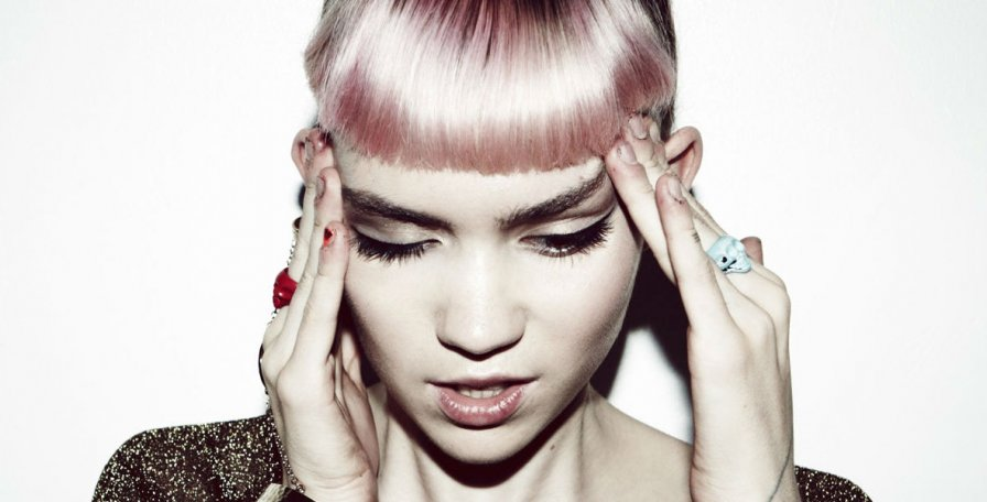 Grimes uses Twitter for good, kinda sorta officially announces new album out this year